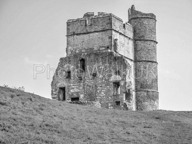 Donnington Castle with blue sky and green grass