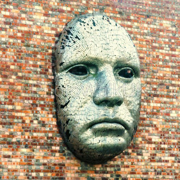 Metal face sculpture on the outside wall of Drill Hall - Photo Walk UK