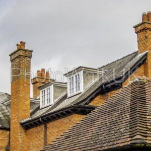 Red roof and chimneys with attic windows. Woodhall Spa. England - Photo Walk UK